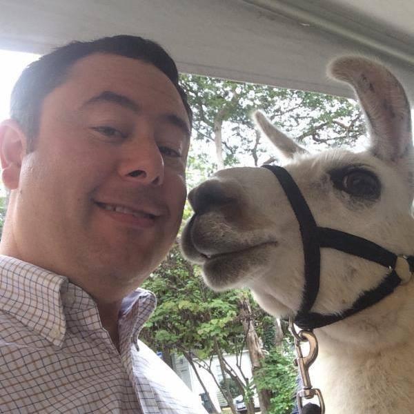 Rabbi David Katz poses with a llama